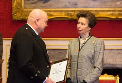 Allan McGinley receiving his butler trust commendation from Princess Royal
