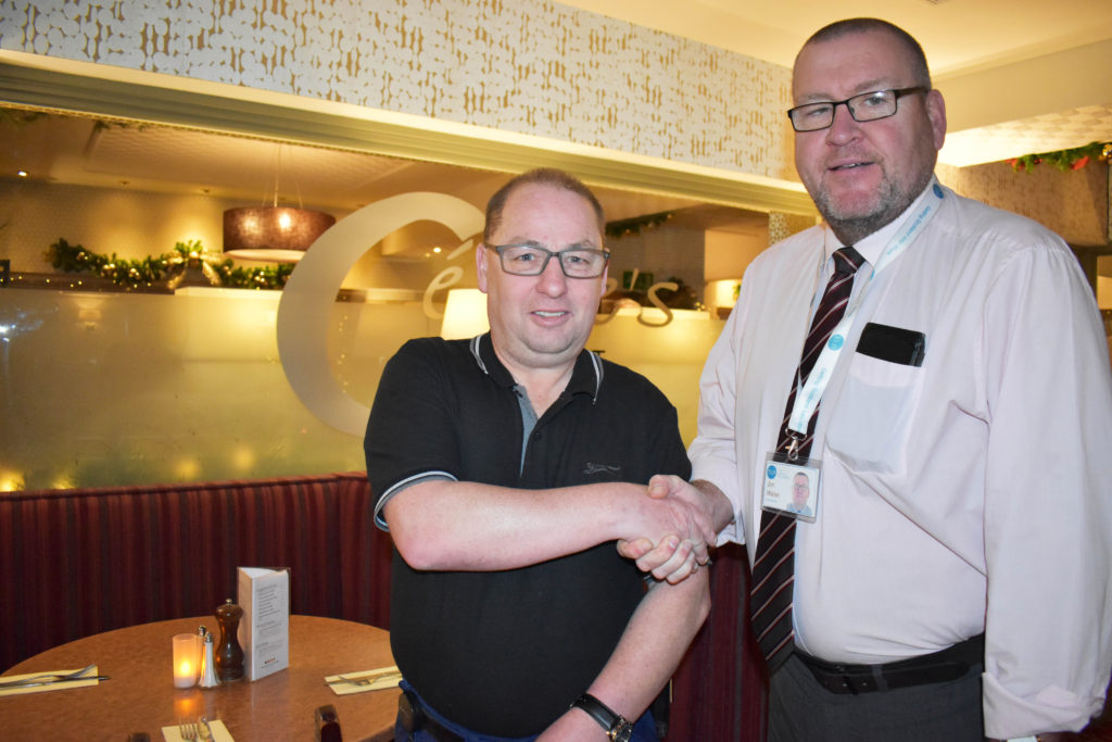 Fair Start Scotland helped James find a job he loves. James is pictured with his work coach Jim