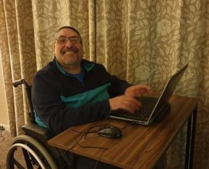 Warren with his new laptop